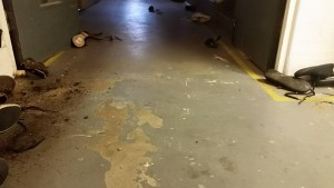 A photo of the studio floor, shoes scattered on either side of the studio floor.